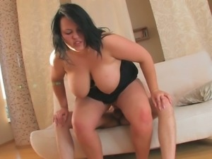 Brunette cute young chick on the couch boned in doggy style