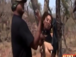 Ebony slut in bondage is eager to please her masters