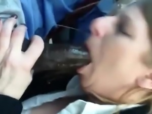 Horny milf sucking a big black cock and swallows his cum