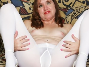 American milf Terri gets naughty in white pantyhose