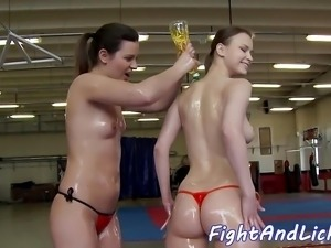 Wrestling lesbian babes covered in lotion