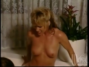 busty ladies have some lesbian fun on the tub