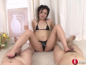 Lusty and hot Japanese chick Rui Natsukawa gives footjob and blowjobs