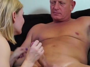 mature blonde works a cock