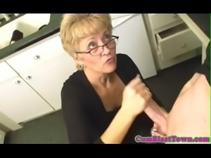 Spex mature receives big cumload in her mouth