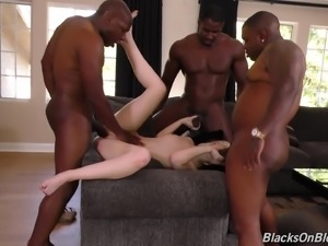 Pale vixen Lily Rader enjoys a gangbang with black fellows