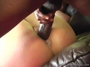 Nasty blonde Barb Cummings bends over for two black dicks