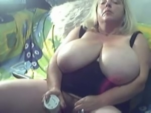 My hot fat wife with huge tits stuffs her hairy cunt with a dildo