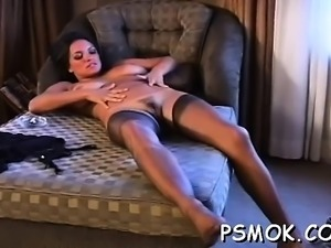 Jaw dropping playgirl teasing with a cigarette in her throat