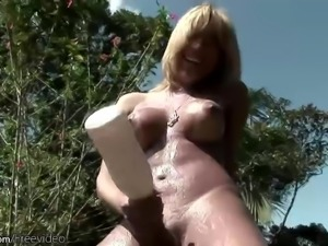 Hypnotic blonde shemale with big ass showcasing her big cock