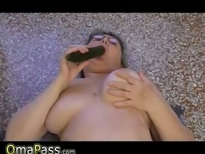 Bored BBW granny with huge soft tits plays with cucumber in kitchen