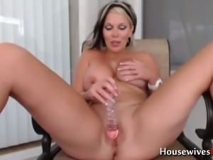 This housewife is a hot cam whore who loves masturbating and she's quite horny