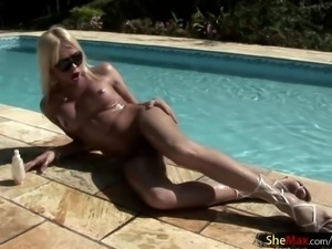 Blonde shemale with nice tits gets frisky with her cock