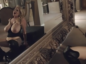 Busty slut Kelly Madison enjoys riding a machine for an orgasm