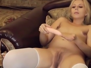 Pregnant blonde playing