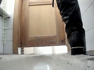 Brunette young sweetie in the public restroom pissing