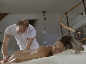 Ardent bosomy blondie gets oiled and fingerfucked during erotic massage