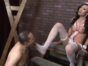 Naughty shemale nurse drills her tool down some poor guy's asshole in a close...