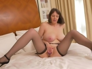 She is sexy, mature and very horny. This lovely woman has huge tits and she...