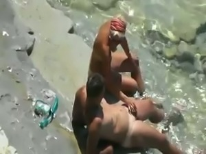 Amateur too tanned blond haired nympho is fucked on beach by her man