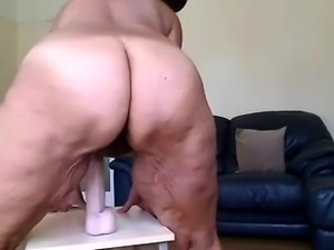 Curvaceous mature lady works her aching pussy on a dildo