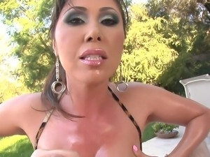 A very busty MILF gives a guy an erotic, oily titjob