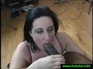 Brunette with big tits sucks on cock