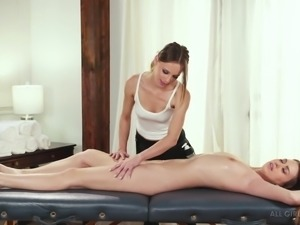 Lesbian Jillian Janson massaging and seducing a good-looking babe