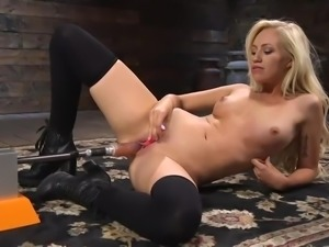 Who needs a man when you can fuck a machine instead? She takes a massive cock...