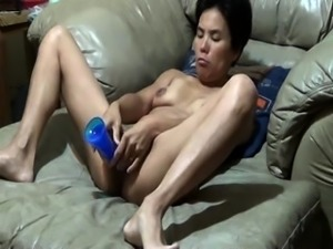 Horny Asian wife with lovely boobs fucks herself with a toy