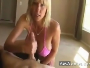Lovely blonde milf with a big pair of boobies giving a long pipe a jerk off