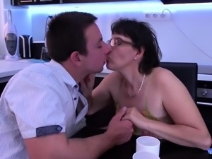 Brunette mom sucks and fucks in the kitchen