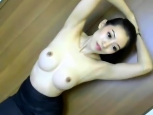 Busty Asian camgirl fucks herself to climax with a dildo
