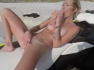 Perfect amateur blonde cutie toying her pussy with a dildo on a jet ski