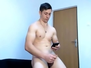 Hunky amateur stud strokes his thick cock for the camera
