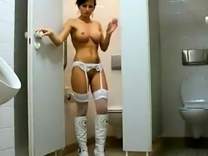 Buxom brunette milf in lingerie blows a cock in the toilet