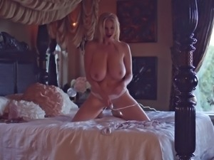 Busty blonde Kelly Madison takes off her lingerie on a bed