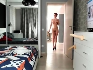 Sexy redhead milf with big tits fucks her peach with a dildo