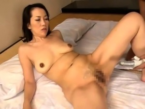 Lustful Oriental mom has a young dick making her cunt happy