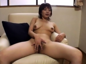 Enticing Oriental milf buries a hard dick in her hairy peach