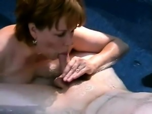 Desirable mature wife with big boobs worships a young cock