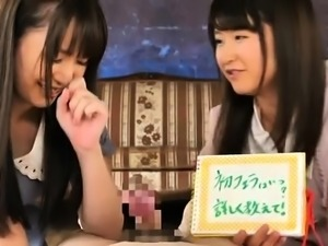 Two adorable Japanese teens work their sexy lips on a dick