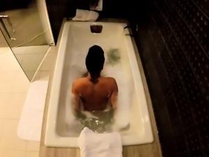 Jezebelle Bond films herself taking a bath