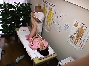 Delightful Oriental girl has a masseur making her cunt happy