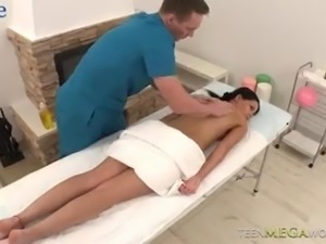 Oiled beautiful Czech brunette Riana G gets fucked from behind hard by masseur