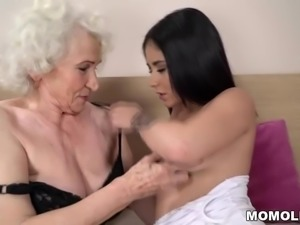 Lusty granny gets wet by a younger girl