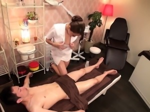 Attractive Asian masseuse seduces a guy to fuck her snatch