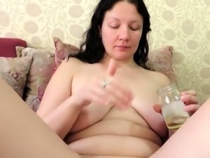 Curvy brunette wife has a guy fisting her tight shaved pussy