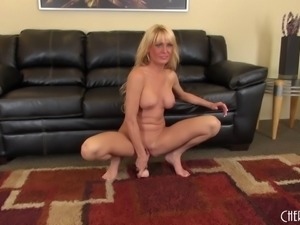 Milf gagging on a toy and fucking her hot cunt with it