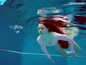 Long haired Simonna is ready to expose her natural pale tits underwater